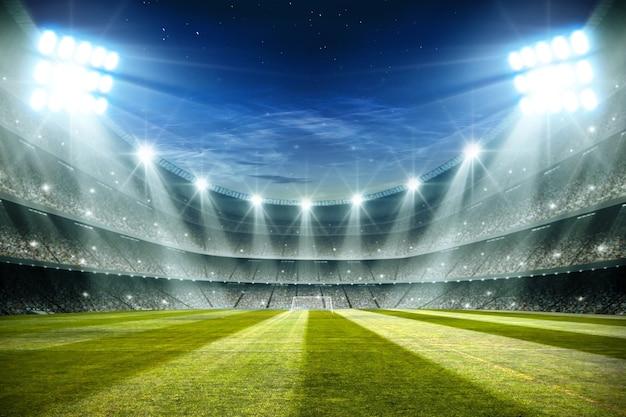 Luces en la noche y la representación 3d del estadio de fútbol