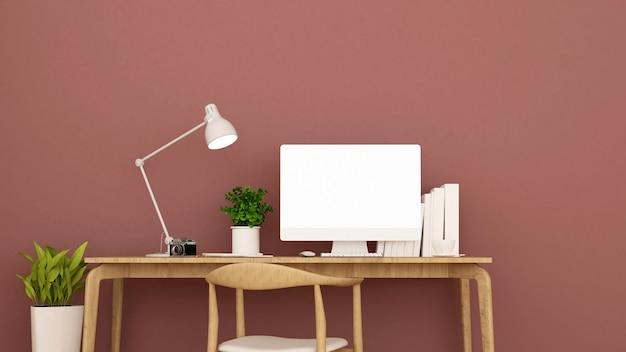 El lugar de trabajo y la pared de color rojo claro decoran.