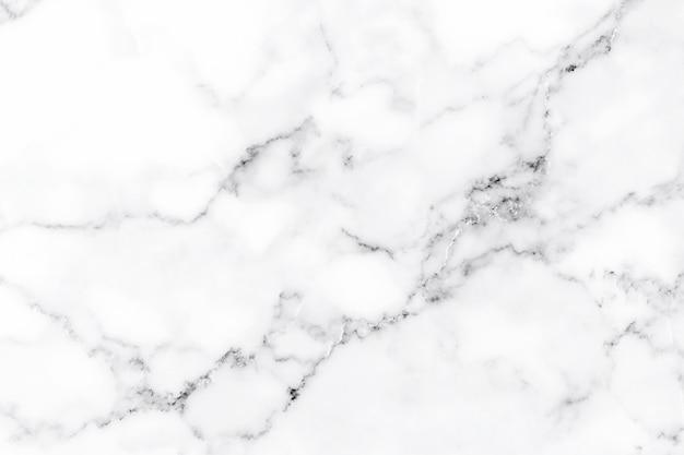 El lujo de la textura de mármol blanco y el fondo para el patrón de diseño.