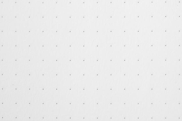 Lunares sobre fondo de papel blanco.
