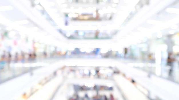 La luz borrosa del bokeh en el centro comercial hall comercial colorido desenfoque arte resumen de antecedentes