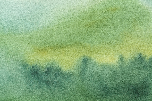 Luz de fondo verde oliva y verde del fondo del arte abstracto. acuarela sobre lienzo con suave degradado cian.