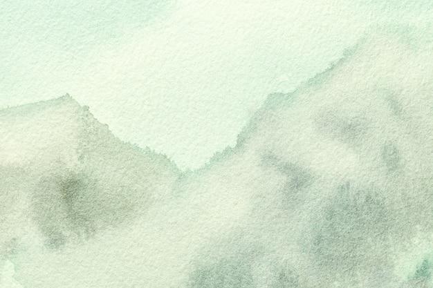 Luz de fondo verde oliva y verde del fondo del arte abstracto. acuarela sobre lienzo con suave gradiente de marfil.