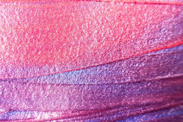 Macro. pintura de tonos morados, rojos y rosados de cerca.