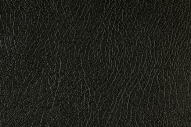 Macro de primer plano sintético de fondo de cuero con textura artificial
