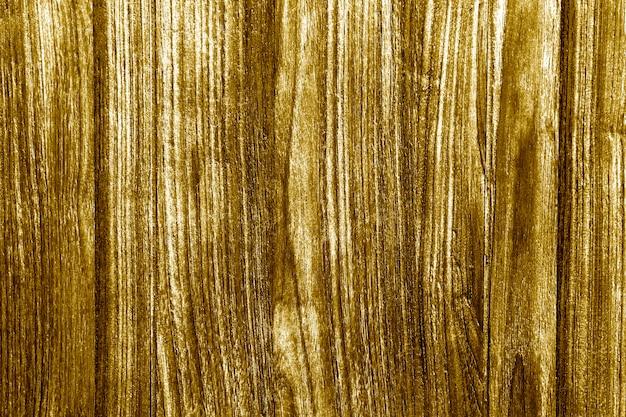 Madera rústica pintada de oro con textura