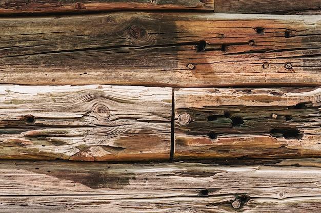 Madera vieja a una textura de fondo de pared.