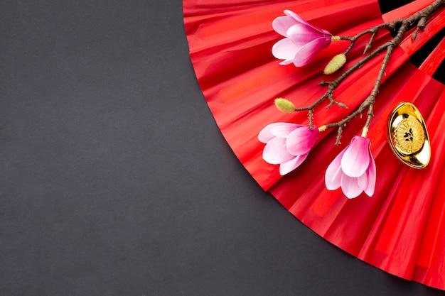 Magnolia y fan año nuevo chino