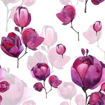 Magnolia roja de capullos y flores sin hojas.