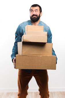 Man holding cajas