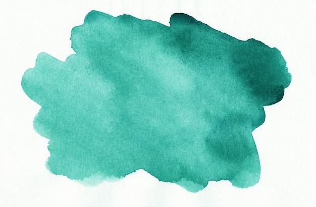 Mancha de acuarela esmeralda sobre fondo blanco. fondo de acuarela verde mar abstracto.