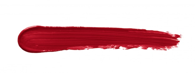 Mancha de lápiz labial rojo aislado en blanco