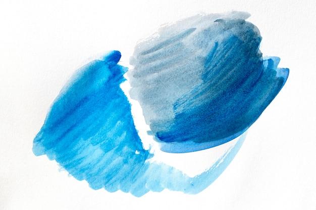 Manchas de pintura azul de arte abstracto