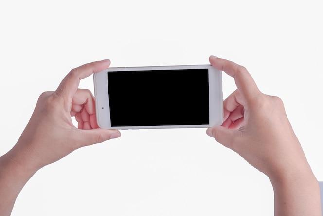 Mano de mujer y teléfono inteligente