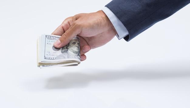 Mano de empresario agarrando billetes de dólar estadounidense, usd