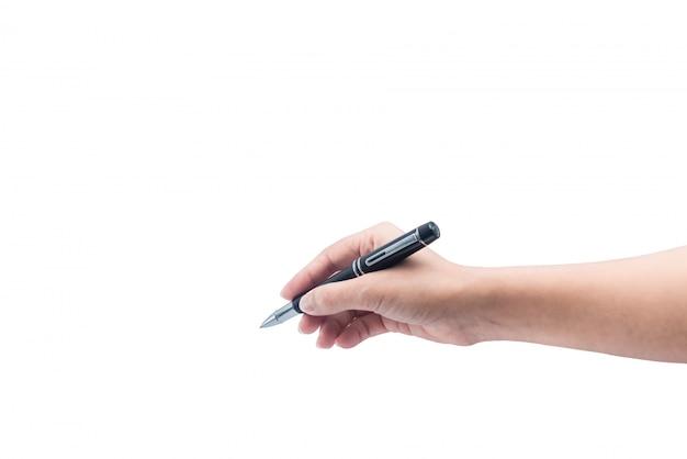 La mano femenina está lista para dibujar con la pluma negra.