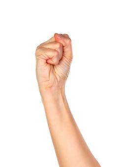 Mano femenina con el puño cerrado