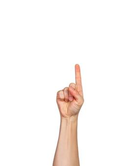 Una mano masculina, los dedos en el puño con el dedo índice apuntando hacia arriba