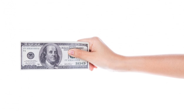 Mano de la mujer con los dólares aislados en el fondo blanco
