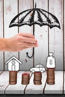 Mano con un paraguas dibujado y monedas