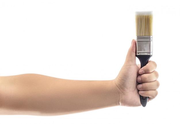 Mano que sostiene el pincel con mango de plástico negro aislado Foto Premium