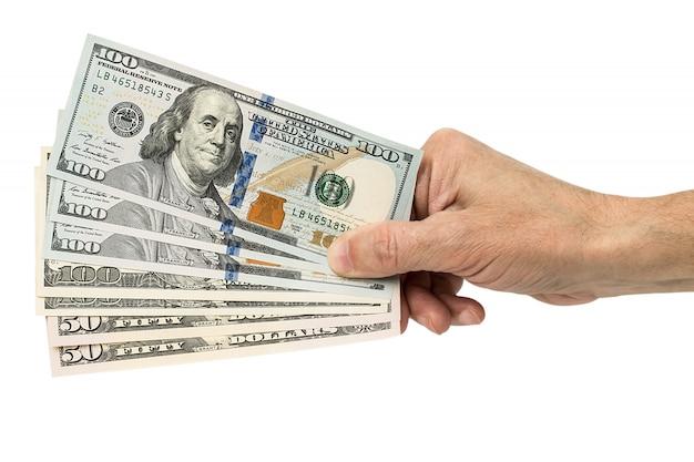 Mano sosteniendo dinero dólares, aislados en blanco