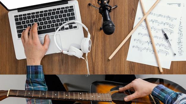 Mano de vista superior escribiendo en la computadora portátil