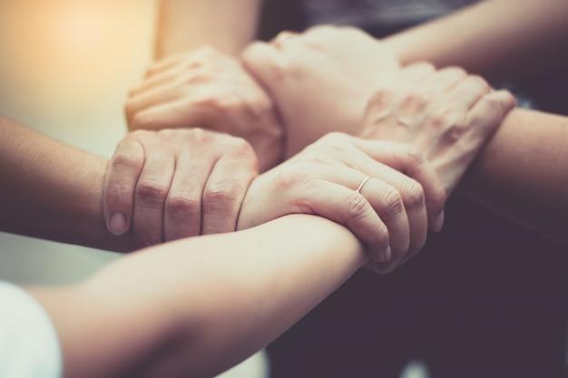 Las manos fueron un concepto de colaboración de trabajo en equipo