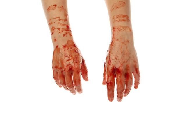 Manos de sangre zombie aisladas en blanco