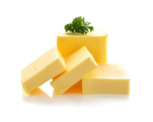 Mantequilla sobre fondo blanco