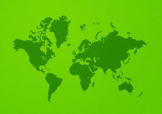 Mapa del mundo aislado sobre fondo de pared verde
