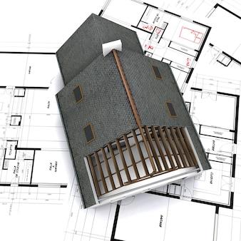Maqueta de la casa sobre planos con notas de bolígrafo rojo y correcciones
