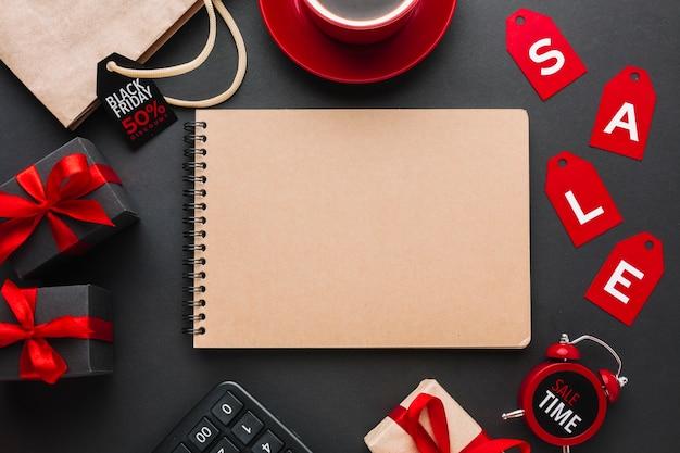 Maqueta de cuaderno con venta sobre fondo negro