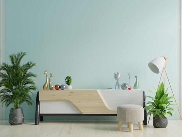 Maqueta del gabinete en la habitación vacía moderna, pared azul.