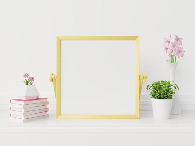 Maqueta de marco amarillo con marco vertical, maqueta de marco en blanco en nuevo interior con representación flowers.3d