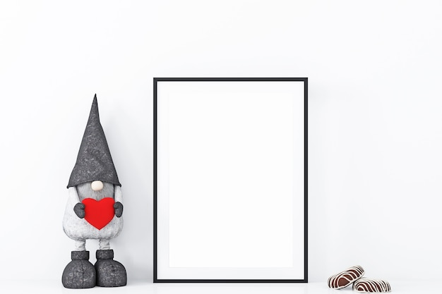 Maqueta de marco con gnomo decorativo y corazón.