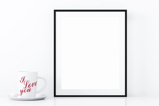 Maqueta de marco negro y taza de amor.