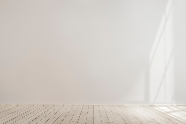 Maqueta de muro de hormigón en blanco blanco con piso de madera