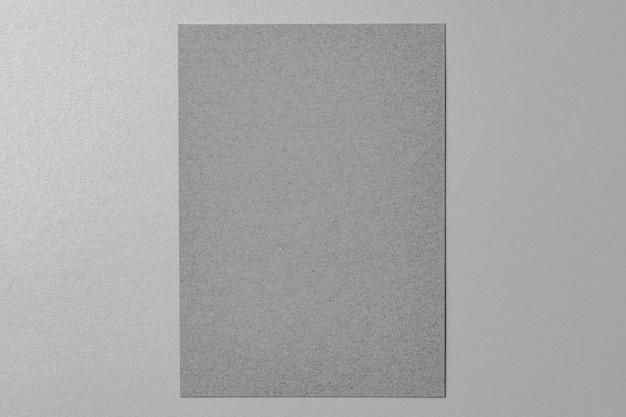 Maqueta de negocios hoja de papel gris sobre fondo gris