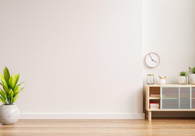 Maqueta de una pared interior en una sala de estar con un gabinete y un fondo de pared blanco vacío