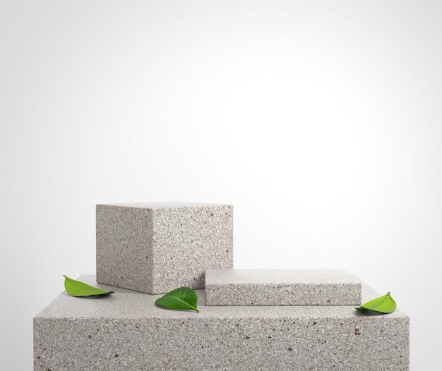 Maqueta de plataforma de podio de piedra con hojas verdes en el piso 3d render