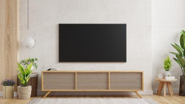 Maqueta de un televisor montado en la pared de una sala de estar con una pared de yeso blanco. representación 3d