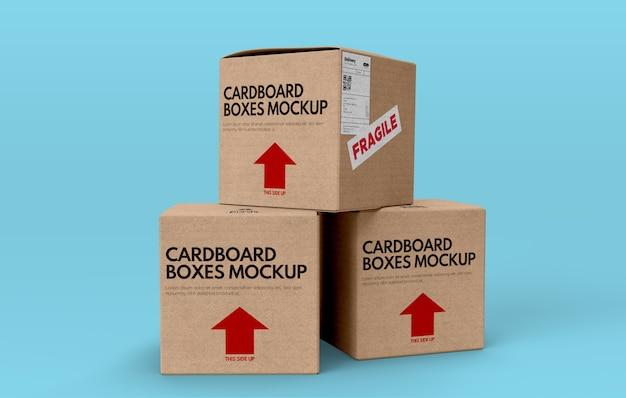 Maqueta de tres cajas de cartón sobre fondo azul