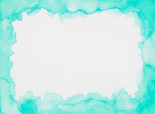 Marco aguamarina de pinturas sobre lámina blanca.