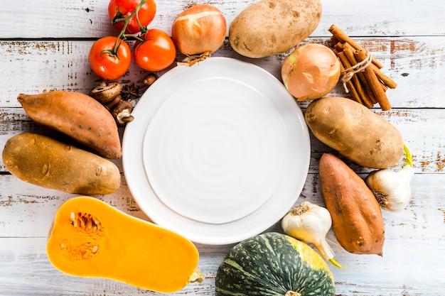 Marco de alimentos vegetales de otoño laicos plana