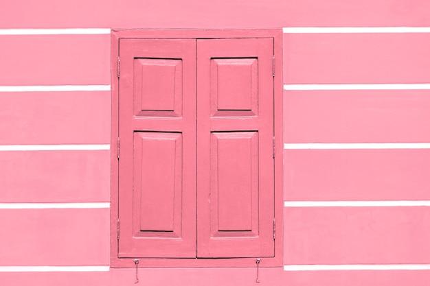 Marco de color pastel de ventana en la pared de estuco del edificio antiguo, fondo, textura, vintage, patrón