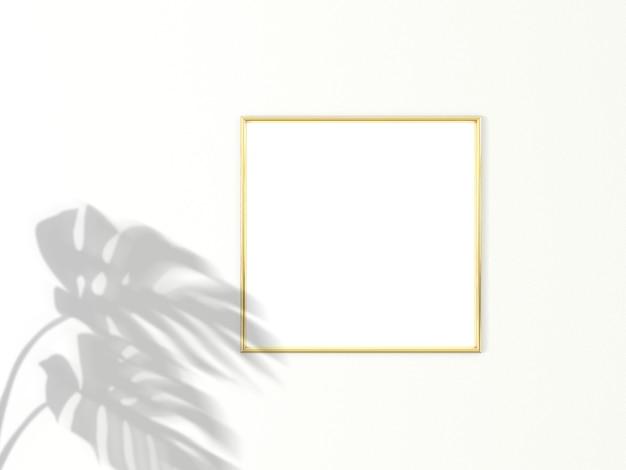 Marco dorado 1x1 cuadrado para maqueta de foto o imagen sobre fondo blanco con sombra de hojas de monstera. representación 3d