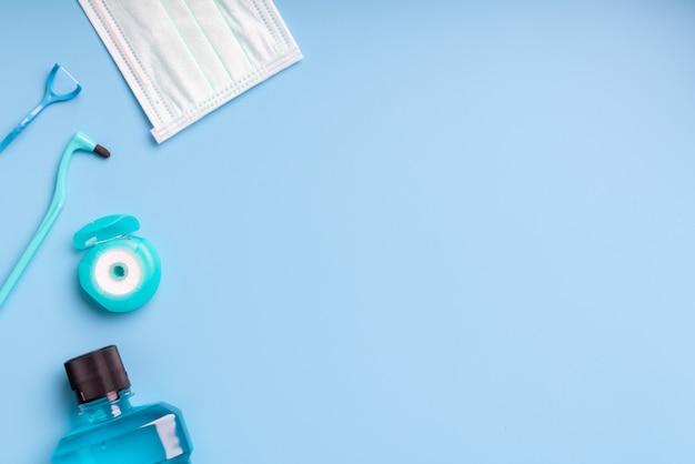 Marco de elementos dentales en azul