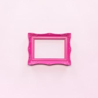Marco de fotos vintage rosa y marco vacío sobre foto gratis