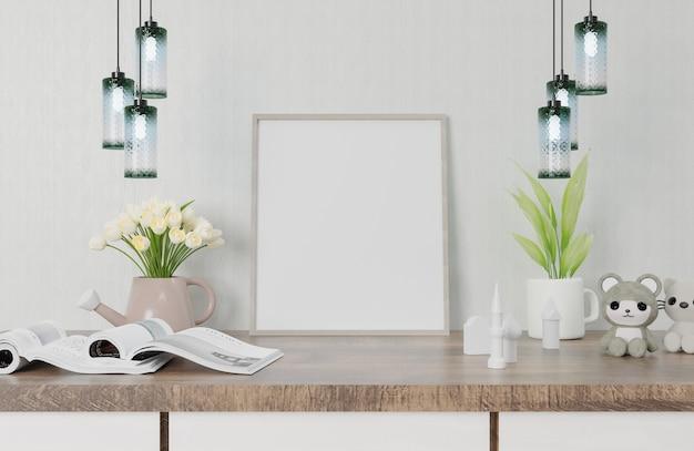 Un marco de imagen blanco colocado sobre una mesa de madera con un árbol libros y muñecos colocados juntos